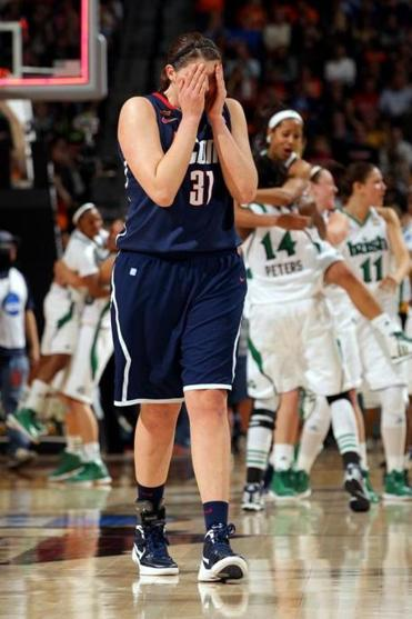Stefanie Dolson and UConn are bounced from the Women's Final Four by Notre Dame in overtime.
